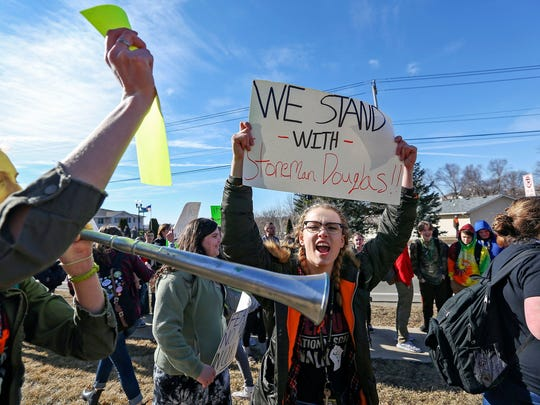 Students at Dubuque Hempstead High School call for gun reform during a walkout on March 14.