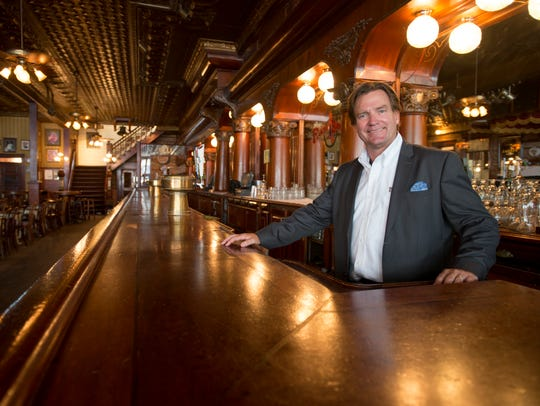 Buck Mitchell, poses at the Rosie O'Grady's bar at