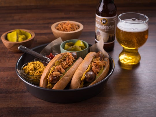 Organic Valley Beer Brats with Maple Beer Mustard are served with condiments and, naturally, a cold beer.
