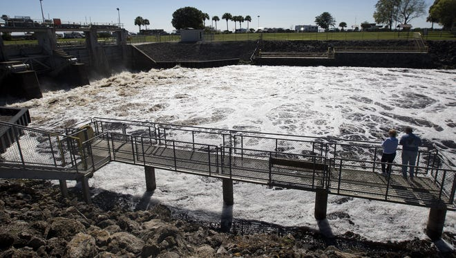 Dirty water discharged from Lake Okeechobee shoots out of the Ortona Locks along the Caloosahatchee River.