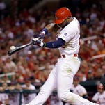 St. Louis Cardinals' Jason Heyward hits an RBI double during the fourth inning of a baseball game against the Chicago Cubs Sunday, June 28, 2015, in St. Louis. (AP Photo/Jeff Roberson)