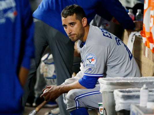 Toronto Blue Jays starting pitcher Marco Estrada sits in the dugout after the seventh inning of a baseball game against the Seattle Mariners, Monday, Sept. 19, 2016, in Seattle. Estrada had a no hitter going into the seventh, but it was broken up when Mariners Robinson Cano hit a single. (AP Photo/Ted S. Warren)