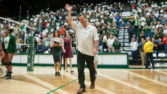 CSU volleyball coach Tom Hilbert acknowledges the crowd's applause Thursday night at Moby Arena after winning his 500th match with the Rams.
