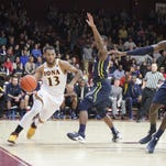 Iona's Jahaad Proctor drives along the baseline during the first half of a game against Drexel. Proctor will transfer after one season at Iona.