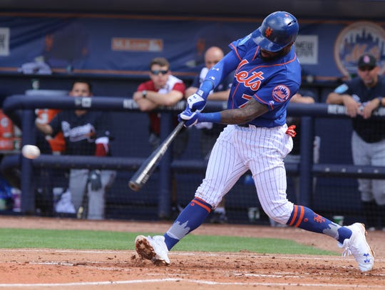 Jose Reyes hits the ball in the second inning. The