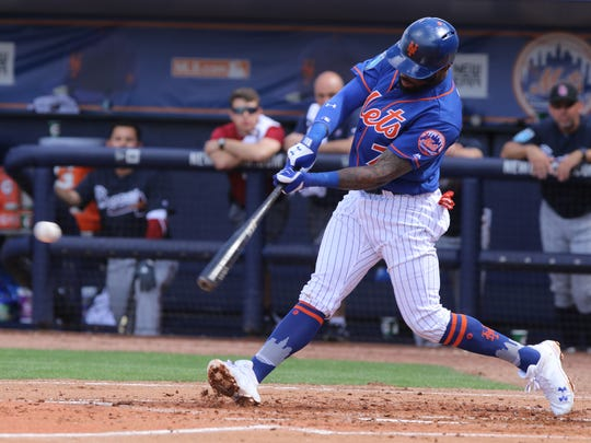 Jose Reyes hits the ball in the second inning. The Mets played their first game of the exhibition season.