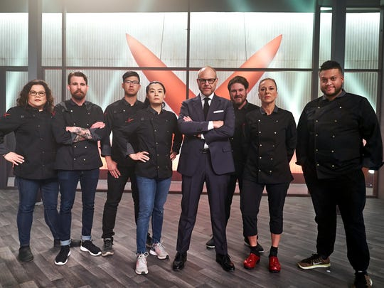Host Alton Brown with the contestants, as seen on Iron Chef Gauntlet, season 2.