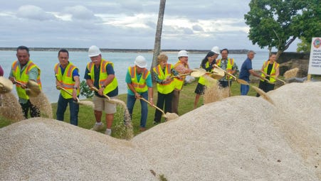 Government officials shovel some gravel in a groundbreaking ceremony for the Guam Fishermen's Cooperative Association's facility on Jan. 28.
