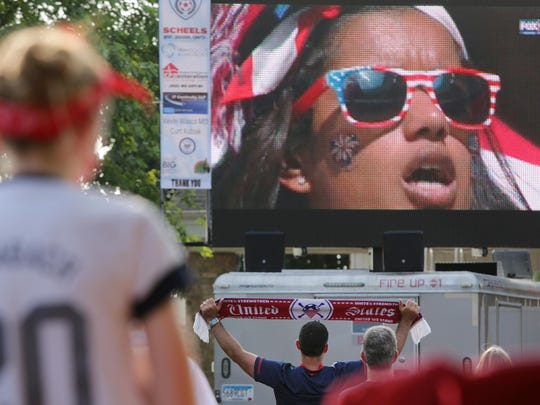 Soccer fans take in a Women's World Cup viewing party Sunday at Greene's Pour House in Neenah as well as in the parking lot of Westgor Funeral Home.
