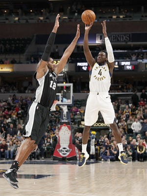 Indiana Pacers guard Victor Oladipo (4) hits the game winning 3-pointer over San Antonio Spurs forward LaMarcus Aldridge (12) with 10 seconds left in their game at Bankers Life Fieldhouse Sunday, Oct. 29, 2017.