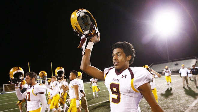 Mountain Pointe's Isaiah Pola-Mao and his teammates celebrate their win over Pinnacle during Division I football quarterfinal action on Friday, Nov. 14, 2014 at Pinnacle High School in Phoenix, AZ.
