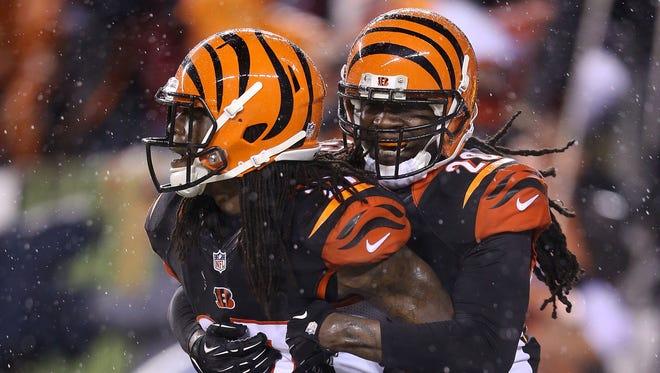 Reggie Nelson, right, congratulates Cincinnati Bengals teammate Dre Kirkpatrick after a touchdown against the Denver Broncos at Paul Brown Stadium on Dec. 22, 2014, in Cincinnati, Ohio.
