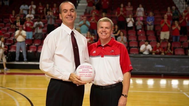 Travis Hudson, left, with WKU athletics director Todd Stewart.