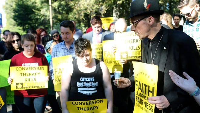 "The Rev. Maurice ""Bojangles"" Blandford, right, of Highland Baptist Church, leads a prayer Oct. 5, 2015, during the Fairness Campaign's protest outside the Association of Certified Biblican Counselors annual conference."