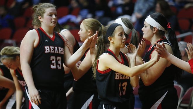 West Branch's Jenae Murry and Kara Fountain high five their teammates after being defeated by Unity Christian's during the Iowa Girls' High School State Basketball Tournament at Wells Fargo Arena in Des Moines, Monday, Feb. 29, 2016.