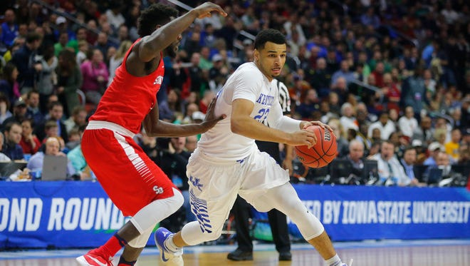 Kentucky's Jamal Murray drives the ball while being guarded by Stony Brook's Ahmad Walker during the Wildcats' game against Stony Brook in the first round of the NCAA Tournament  on Thursday, March 17, 2016, at Wells Fargo Arena in Des Moines.