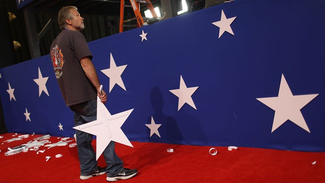 John Sexton places stars on the walls Sunday as he helps prepare the Quicken Loans Arena for the Republican National Convention.