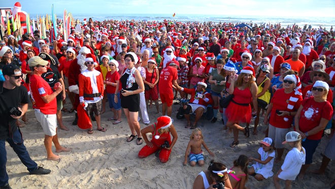 Thousands of Surfing Santas and spectators turned out on Dec. 24, 2016, in Cocoa Beach, Fla., to catch a wave or a glimpse of an elf in the ocean. The event started eight years ago when George Trosset went out surfing in a Santa suit with his son and daughter-in-law.