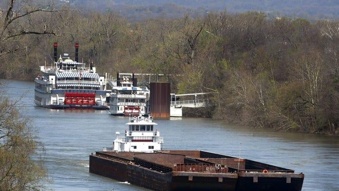 Ingram Barge Co.'s HB Stewart, front, passes the General Jackson and another showboat as it travels toward Nashville on April 1, 2009, on the Cumberland River.