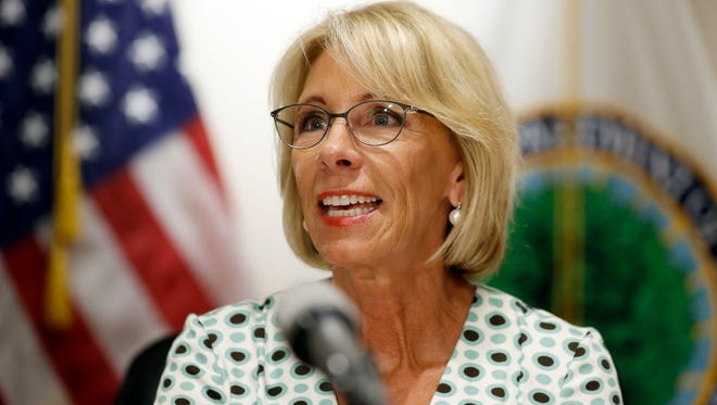 Education Secretary Betsy DeVos speaks with the media after a series of listening sessions about campus sexual violence in Washington on July 13, 2017.
