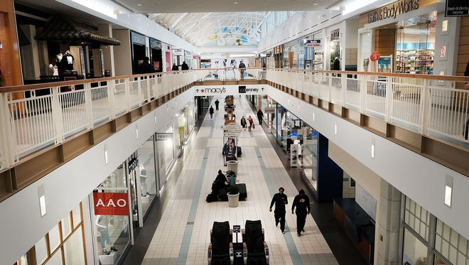 People walk through a nearly empty shopping mall on March 28, 2017. in Waterbury, Conn. As consumers buying habits change and more people prefer to spend money on technology and experiences like vacations over apparel, shopping malls across the country are suffering.In the last decade dozens of malls have closed as retailers like JCPenney, Macy's and Sears, known as 'anchor stores,' close hundreds of locations do to falling sales. Real estate firm CoStar are projecting that nearly 25% of American malls are in danger of losing their anchors stores.