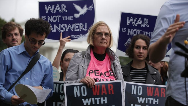 "Activists participate in a protest in front of the White House Oct. 12, 2017 in Washington, DC. Activists held a rally to ""denouncing President Trump's anticipated decision to decertify the Iran nuclear deal."