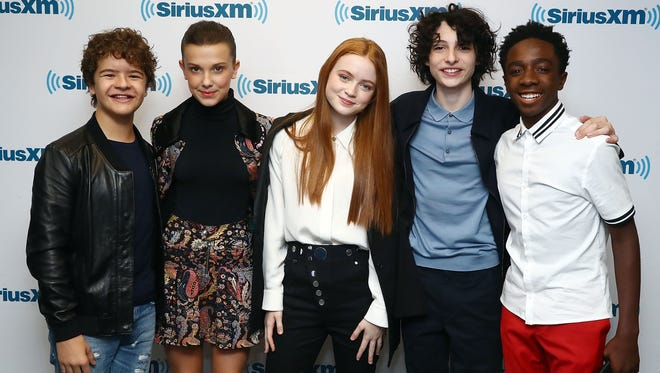 (L-R) Gaten Matarazzo, Millie Bobby Brown, Sadie Sink, Finn Wolfhard and Caleb McLaughlin attend SiriusXM's 'Town Hall' for the cast of Stranger Things on SiriusXM's Entertainment Weekly Radio on Nov. 1, 2017 in New York.
