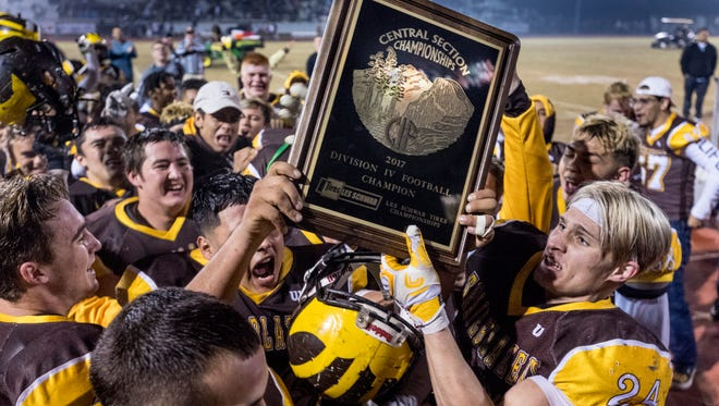 Golden West celebrates their win over Central Valley Christian in a Central Section Division IV high school football game on Friday, December 1, 2017.