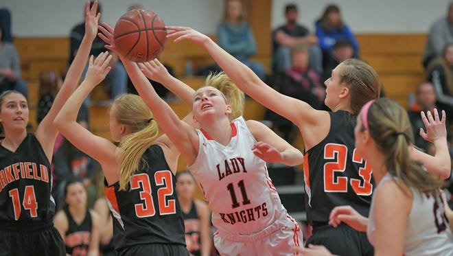 Alexis Rolph (11) of Lourdes stretches for a rebound in the first half. The Lourdes Academy Knights hosted the Oakfield Oaks in a Trailways -East conference match up Thursday evening, February 15, 2018 at the Castle.