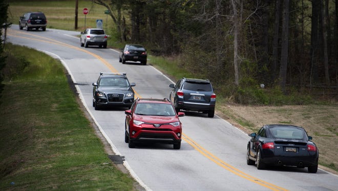 Cars drive down Roper Mountain Road on Wednesday, April 4, 2018.