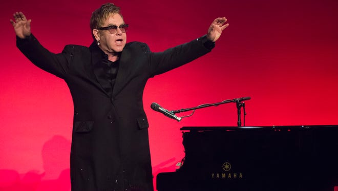 "Elton John performs at the Elton John AIDS Foundation's 13th Annual ""An Enduring Vision"" benefit at Cipriani's Wall Street on Tuesday, Oct. 28, 2014, in New York."