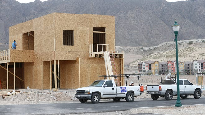The first single-family home is under construction in the Montecillo Smart Growth community.  Hundreds of apartments, some of them in the background, were the first housing built in the West El Paso development.