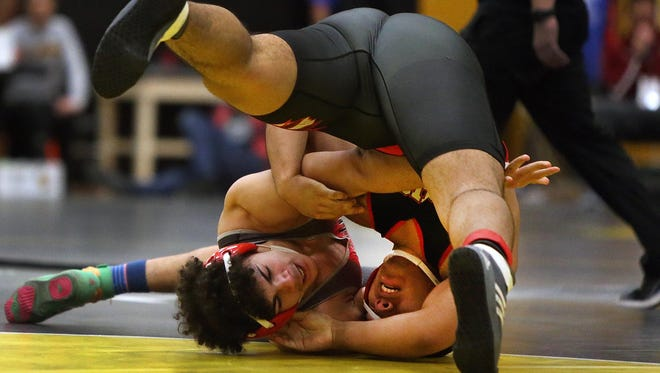 Perth Amboy's David Welch (left) and Bishop Ahr's Freddy Ramirez wrestle at 220 pounds during the opening round of the GMC Wrestling Tournament on Friday, Jan. 26, 2018.
