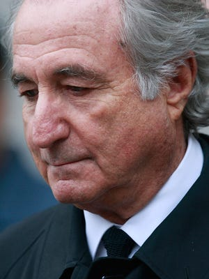 File photo taken in 2009 shows Ponzi scheme architect Bernard Madoff leaves Manhattan federal court in New York City after a hearing.