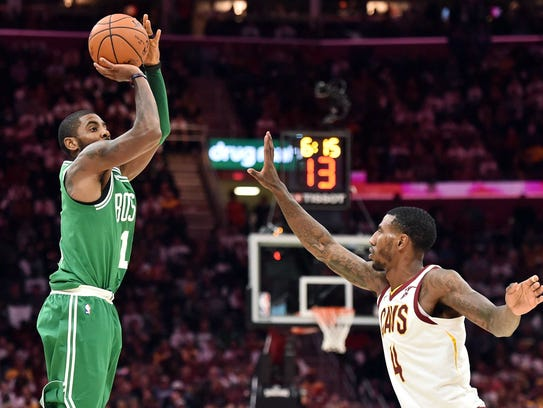 Boston Celtics guard Kyrie Irving (11) shoots over