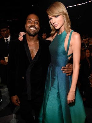 Kanye West and Taylor Swift are pals at the 57th Annual GRAMMY Awards on Feb. 8, 2015 in Los Angeles.