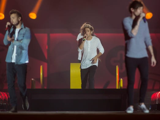 One Direction performs during the the One the Road