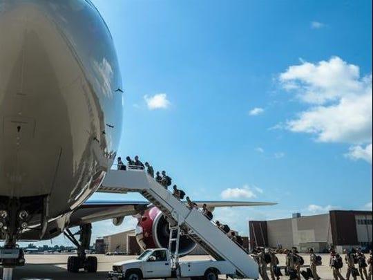 Barksdale Airmen board a plane to deploy to Al Udeid