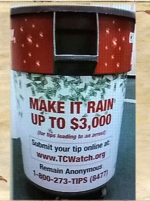 Treasure Coast Crime Stoppers wraps trash cans at Vero Beach High School with message.