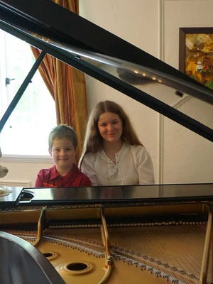 Maria Beloreshka, 13, right, and her brother Alexander, 10, will perform in the Crescendo International Music Competition on Friday, Jan. 12, at 7:30 p.m., in the Weill Recital Hall of Carnegie Hall, 154 West 57th St., New York, NY.