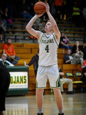 Wood Memorial senior Lathan Falls attempts a free throw earlier this season. The Trojans are 7-3 and ranked No. 10 in the latest Class 1A poll by the Associated Press.