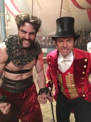 """Tim Hughes and Hugh Jackman on the set of """"The Greatest Showman."""" Hughes currently performs in """"Hadestown"""" musical in New York."""