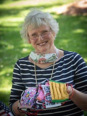 Linda Carroll of Mansfield has sew 700 masks which she gives to family friends, as well as health care, retail and restaurant workers.