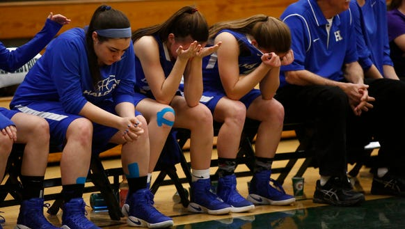Haldane players sit on the bench in the closing seconds