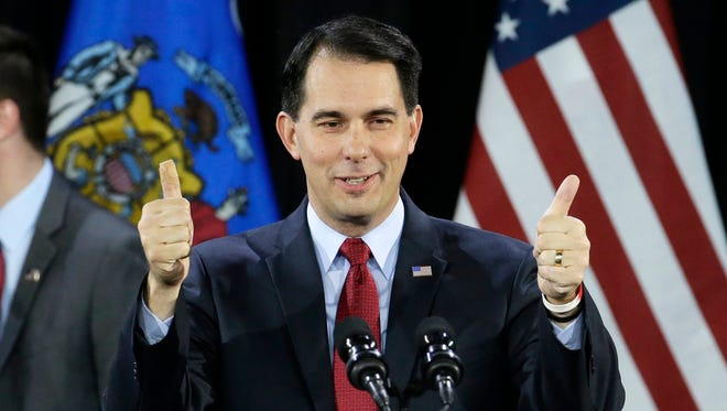 Wisconsin Gov. Scott Walker gives a thumbs-up as he speaks at his election night campaign party in West Allis Nov. 4.