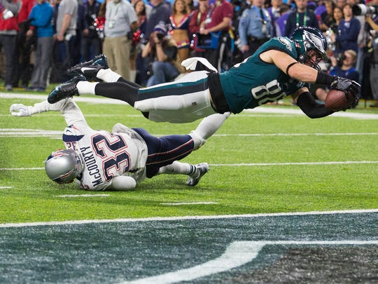 Eagles tight end dives into the end zone to score Sunday night at US Bank Stadium. The Eagles defeated the New England Patriots 41-33 to win Super Bowl LII.