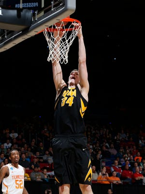 Iowa Hawkeyes center Adam Woodbury (34) dunks the ball in the second half of a college basketball game against the Tennessee Volunteers during the first round of the 2014 NCAA Tournament at UD Arena.