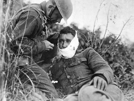 A wounded soldier from the 110th Infantry Regiment receives treatment on the battlefield at Varennes-en-Argonne, France on Sept. 26, 1918. More than 26,000 American troops were killed in the Meuse-Argonne Offensive.