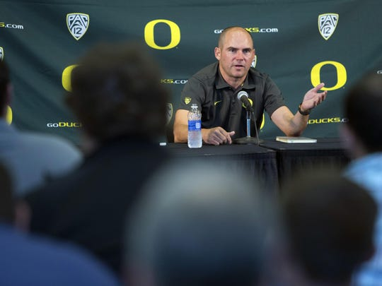 Oregon football head coach Mark Helfrich answers questions from the press during Media Day at Autzen Stadium in Eugene, Ore., on Monday, Aug. 10, 2015. The Ducks started their fall camp on Monday and will open their season against Eastern Washington on Sept. 5. (Andy Nelson/The Register-Guard via AP)