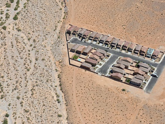 A small Las Vegas neighborhood is surrounded by open desert.